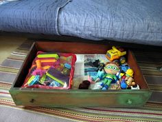 Put wheels on a dresser drawer for under bed storage.  I nabbed some drawers off a throw away dresser and they are awesome roll out storage under the bunk beds. :)