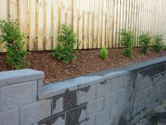 front yard retaining wall along the fence.