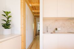Image 13 of 21 from gallery of 4 Houses in Graça / Lioz Arquitetura. Photograph by Francisco Nogueira The Doors, Small Apartments, Small Spaces, Stone Kitchen, Small Space Storage, Storage Solutions, Architecture Design, Bathtub, House Design
