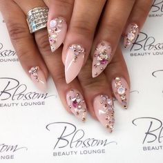 Nude pink stiletto nails with bling