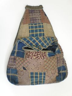 """""""This pocket is an unusual example of a decorative pocket from c.1830-40s. The front layer is pieced together from squares and rectangles of roller printed dress cottons in predominantly blues, purples and brown/yellows, and the back of the pocket is one piece of printed foliate pattern cotton in brown and cream.  """"  ...~♥~"""