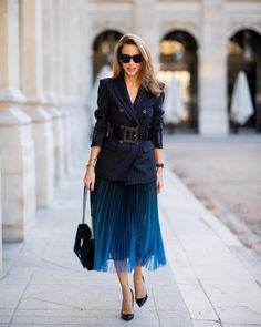 Alexandra Lapp is wearing pleated skirt, navy striped blazer with belt and bag all Marc Cain, heels is seen during Paris Fashion Week Womenswear Spring/Summer 2019 on September 2018 in Paris, France. (Photo by Christian Vierig/Getty Images) Blue Pleated Skirt, Pleated Skirt Outfit, Skirt Outfits, Classy Outfits, Chic Outfits, Fashion Outfits, Womens Fashion, Modest Fashion, Skirt Fashion