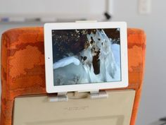 iPad stand that becomes a heads-up display in a coach airline seat