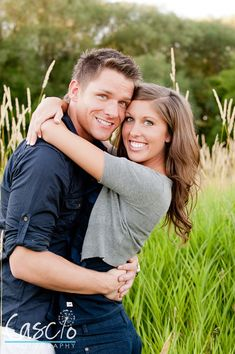 Sweet engagement photo.  Two smiling people both looking at the camera!
