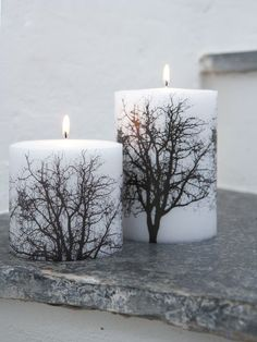 Black and white tree pillar candles