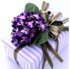 Gift Wrapping Ideas- Love the idea of putting fresh flowers on a special gift!