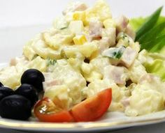Russian Salad (Olivier - Оливье), typically made from chopped potatoes, vegetables and meat in a mayo dressing.