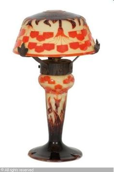 LE VERRE FRANÇAIS Lamp in yellow, orange, brown glass, wrought iron - verre jaune orange brun a decor de fleurs stylisees. Monture en fer forgé (hva)