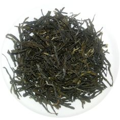 "Green Tranquilitea - This tea is so named as it is guaranteed to bring a smile back on your face, especially after a long day's work. Due to our unique manufacturing process, this tea has a unique ""peaty"" flavor to it and is savored by single malt connoisseurs."
