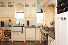 Traditional, charming, custom kitchen - would it surprise you to know that these are refaced cabinets, and that they used to be contemporary?