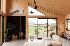 Windows are carefully positioned to screen out neighbours and frame the views. The home's owner...