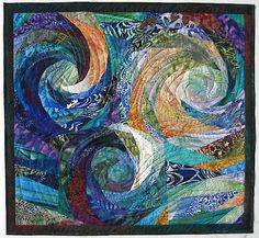 Beautiful & colorful swirls quilt.   Reminds me of Van Gogh's Starry Night