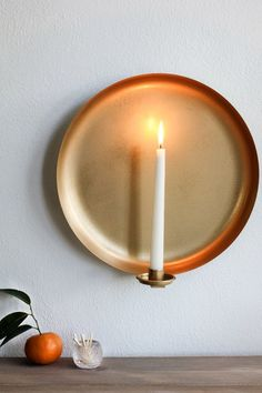 DIY brass candle sconce candle sconces We Hacked a Target Serving Platter Into a Beautiful Brass Sconce Brass Sconce, Candle Wall Sconces, Diy Candle Holders, Diy Candles, Ikea Lamp, Pot Of Gold, Serving Platters, Diy Wall, Decorative Items