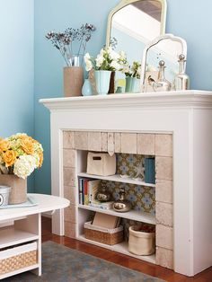 Creative idea for an unused fireplace. Wallpaper gives it a colorful pop.