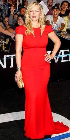 KATE WINSLET She's back! Also at the Hollywood premiere of Divergent, Kate makes her return to the red carpet in a crimson SAFiYAA gown, accessorized with an Alexander McQueen clutch and Ana Khouri earrings.