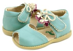 Merrybell Light Blue Toddler  Merry Bell evokes the feeling of frolic and fancy in childhood summers - think a secret garden with delicate vines and falling blossoms. With its dangling tassels and scalloped edging in contrasting color, this peep-toe sandal is feminine and sweet