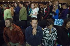 U.S. pilgrims pray after receiving Communion from Cardinal Dolan during Mass at World Youth Day in Brazil  World Youth Day pilgrims pray after receiving Communion from New York Cardinal Timothy M. Dolan during a Mass at the Rio Vivo Welcome Center in Rio de Janeiro July 24. The site also will feature prayer and worship experiences, music, media and videos, motivational speakers, cultural presentations and networking activities for World Youth Day pilgrims. (CNS photo/Tyler Orsburn)