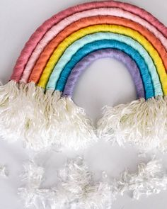easy DIY- how to make a rainbow wall hanging out of rope. This fiber art is the perfect statement art in a home. Rainbow Nursery, Rainbow Wall, Cake Rainbow, Rainbow Birthday, Rainbow Colors, Baby Room Diy, Baby Room Decor, Nursery Decor, Rainbow Project