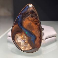 A personal favorite from my Etsy shop https://www.etsy.com/listing/521334582/sale-boulder-opal-ringnatural-opal