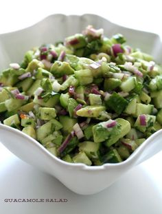Paleo Guacamole Salad | by Health-Bent | INGREDIENTS: 2 diced avocados, 1 diced English cucumber, 4 diced tomatillos, 1/2 finely diced red onion, handful chopped cilantro, 2 juiced limes, salt | DIRECTIONS: Remove the green husks from tomatillos. Under warm water. Chop all ingredients, add to bowl, and mix.