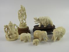 Lot 269 - An Indian ivory carved herd of elephants, largest 8cm long, a further elephant raised on a wooden