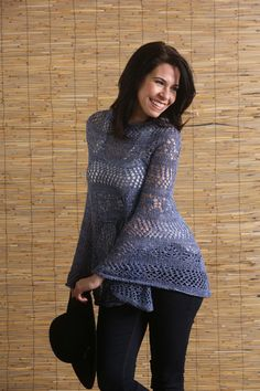 This pretty lace poncho is a casual alternative to a summer cardigan – and much easier to knit than a sweater! It features different lace combinations broken up by rows of stockinette stitch. Cover-up for the beach or wear as a poncho for summer errands.