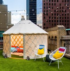 """Only in New York can you camp in a $2,000-a-night yurt. The tent-like structure historically favored by Mongolian nomads is now an option at the W hotel in midtown Manhattan. The tent structure is built on the sweeping terrace of an """"Extreme Wow"""" one-bedroom suite on the 17th floor of the hotel. It even has a private deck and fire pit! Click through for more photos of this amazing New York City glamping site."""