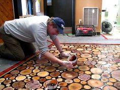 sanded wood discs floor epoxied.... Beautiful floor. Basement?? entryway?