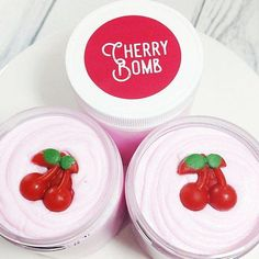 Our Cherry Bomb whipped sugar scrub is for the fruity fans who like it bold and sweet. This delicious cherry will bring a slight pucker to your bath time and lather your skin in cherries and vanilla. We top all our body scrubs with fun little glycerin soaps under each lid so of course we had to add a little bundle of soap cherries.Pinch out a handful in your shower and best when added to a shower puff for creamy and dreamy bubbles. The sugar will exfoliate #CelluliteRemovalGel Whipped Soap, Whipped Body Butter, Shea Butter, Summer Party Favors, Body Scrub Recipe, Herbalism, Cherry, Body Scrubs, Bath Time
