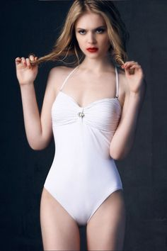 Swimsuit made of spandex and nylon, featuring halterneck style, soft-handle cups with twist design, rhinestone embellishment to centre front.