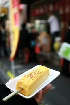 Tamagoyaki (Japanese Rolled Egg Omelet / Sushi Egg) on a Stick, at Tokyo Tsukiji Fish Market|築地の卵焼き
