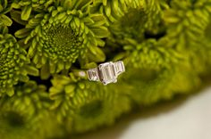 macro of the engagement ring positioned in bouquet