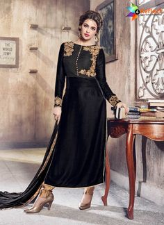 c618eae42f37f6 Grab this enchanting black karachi boutique style dress for ceremonies.  This trouser style salwar suit has full sleeves