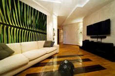 Huge palm leaf mural adds a color & sophistication to this contemporary living room. Available every day at ArtisticWallMurals.com.