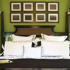 Hang multiple, uniform-sized picture frames, with simple artwork, side-by-side above your bed. This easy trick is a great way to fill a large space when you can't afford big pieces of art.