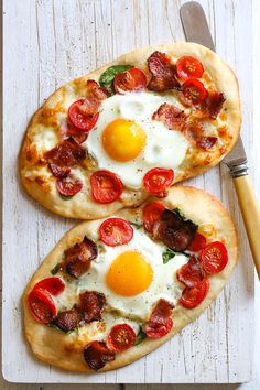 This easy, homemade breakfast pizza is made with bacon, eggs, tomatoes, spinach and cheese, made from scratch and ready in less than 30 minutes start to finish!