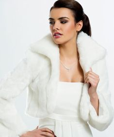 Stylish faux fur bridal bolero wedding jacket made from high quality faux fur with collar Beautifully soft and lined inside Available in Winter Wedding Coat, Wedding Fur, Wedding Jacket, Color Ivory, Clothing Store Design, Wedding Dress Accessories, Strapless Gown, Lace Sleeves, Fur Jacket