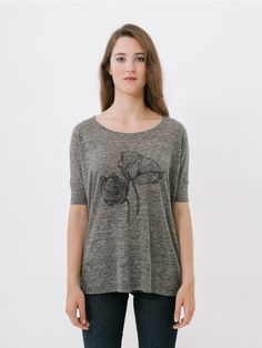 Flora Grey T-Shirt// Sometimes it's tricky to find a T-shirt that meets the two basic requisites for day to day wear: comfort and style. If that's what you're looking for, you have come to the right place. The Flora T-shirt is slightly oversized and is created from a speckled grey linen fabric. With silk screened floral style logo. Oversize/Comfort fit.