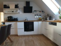 Patrick from Warin in Germany designed his new IKEA METOD kitchen. The white cupboards, mixed with wood surface and open shelves give it a warm but functional feel.  