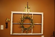I got this window at an antique shop for $3.15 because one of the panes had been broke. So I finished breaking out the rest of the glass and hung a wreath on it.