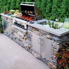 A stone kitchen can be both functional and pretty. It is really a great place for a summer party with an amazing oven and a beer cooling poor.