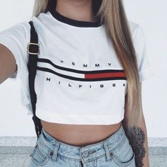 Top: tommy hilfiger crop top, tommy hilfiger, cropped t-shirt, 90s style, high waisted jeans, tattoo, crop tops, t-shirt, white t-shirt, love, brand - Wheretoget