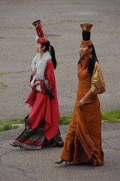 Mongolian Women in fancy hats.