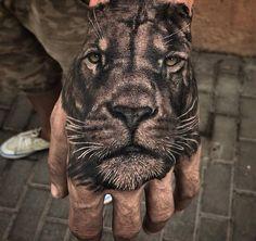Lion tattoo on hand Tiger Hand Tattoo, Mens Lion Tattoo, Hand Tats, Hand Tattoos For Guys, Cat Tattoo, Unique Tattoos, Cool Tattoos, Amazing Tattoos, Beautiful Tattoos