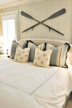 Crossed oars or paddles make for a great dimensional nautical accent wall. You can do this above the bed, above the sofa, or above a console table for example. You could also paint the oars anyway that fits your taste and decor. Click on link to see many mor oar decor ideas on Completely Coastal. Source unknown for this particular image. Master Bedroom Layout, Dream Master Bedroom, Bedroom Layouts, Home Bedroom, Bedroom Decor, Bedroom Ideas, Master Bedrooms, Master Suite, Budget Bedroom