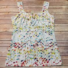 """🌹 HP NWT Ann Taylor White Floral Design Top Small 🌹 Host Pick for the Wardrobe Refresh Party 2-17-16 Chosen by @lwschlprncss ❤️ NWT Ann Taylor White Top with multi color floral designs. Size is Small. 95% Polyester, 5% Spandex. Bust area is lined in White 100% Polyester. Measurements laying flat: Bust 16.5"""", Length 24"""". Mannequin is a 36-24-36 to give you an idea of fit. Machine Wash Cold. 🚫No Trades, PayPal or Low Ball Offers🚫 Ann Taylor Tops Tank Tops"""
