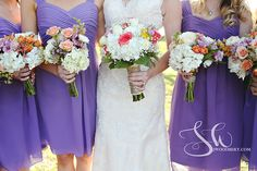 Allison's bridesmaids wore lavender knee length dresses and carried clutch bouquets of Escimo roses, lavender alstroemeria, tangerine spray roses, white hydrangea, peach spray roses, pink wax flower, blush ranunculus, and yellow statice | by Dorothy McDaniel's Flower Market
