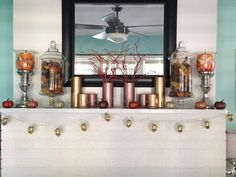 My autumn mantle. Vases from dollar store and then spray painted them with gold and cooper paint. Glittered branches (from my yard) and glittered mini pumpkins