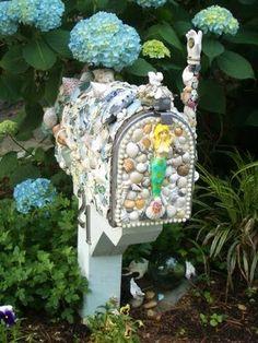 Shell Mosaic Mailbox Keep garden tools inside.