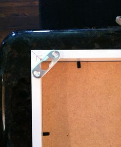"""FINALLY, a Ribba frame hanging mechanism that the Hubs is happy with. Maybe my glitter """"art"""" will be up before 2012!"""